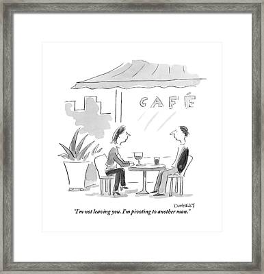 A Man And A Woman Are Seen Sitting And Talking Framed Print