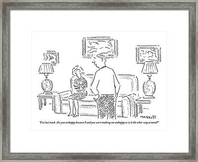A Man And A Woman Are Seen Talking In A Living Framed Print