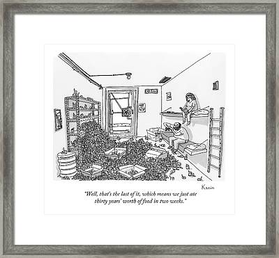 A Man And A Woman Sit On Beds Against A Wall Framed Print