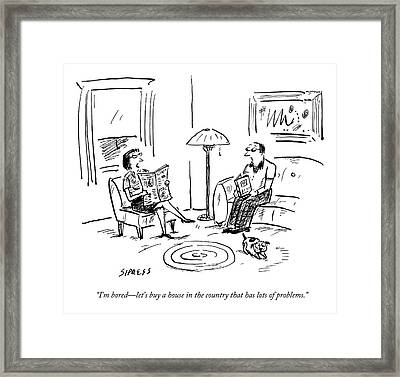 A Man And A Woman Talk In Their Living Room Framed Print