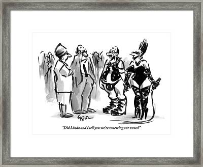 A Man And A Women Are Seen Dressed In S&m Gear Framed Print