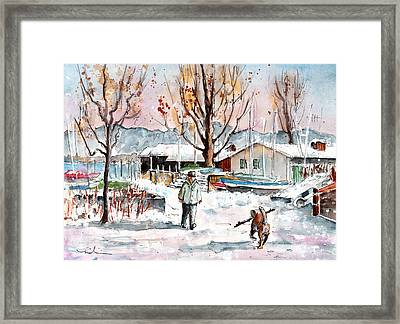 A Man And His Dog On Lake Constance Framed Print by Miki De Goodaboom