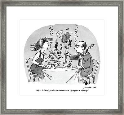 A Man And Woman Are Seated At A Table But Framed Print
