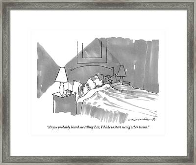 A Man And Woman Are Talking In Bed Framed Print