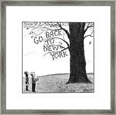 A Man And Woman Look At A Single Tree In A Field Framed Print