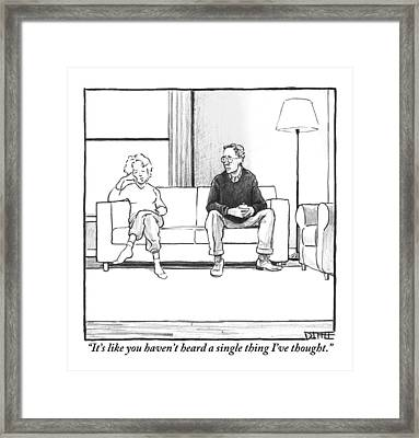 A Man And Woman Sit Next To Each Other On A Couch Framed Print