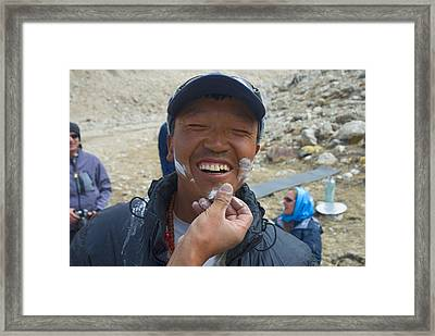 A Man At The Tsampa Ceremony After Puja Framed Print
