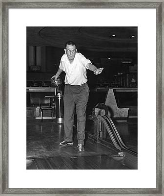 A Man Bowling Framed Print by Underwood Archives