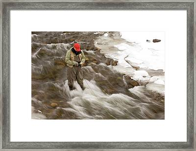 A Man Chooses A Fly While Fishing Framed Print