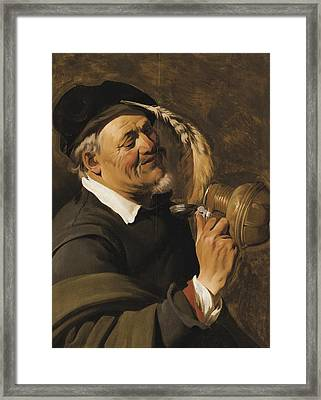 A Man Drinking From An Earthenware Flagon Framed Print by Celestial Images