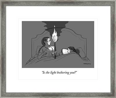 A Man Holds A Torch In Bed As His Reading Light Framed Print