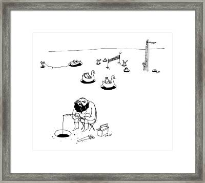 A Man Ice Fishes Through A Whole Framed Print