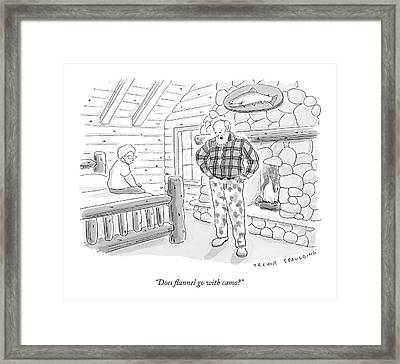 A Man In A Log Cabin Wears A Flannel Shirt Framed Print
