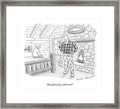 A Man In A Log Cabin Wears A Flannel Shirt Framed Print