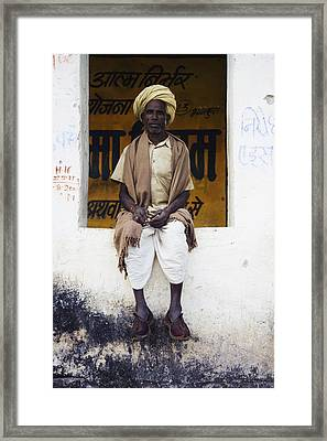 A Man In Clogs Sitting In A Window In Framed Print by Alan Williams