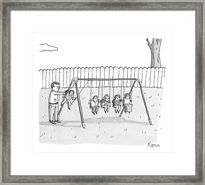 A Man Is Seen Swinging A Group Of Kids Like A Set Framed Print