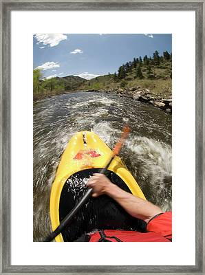 A Man Kayaking On The Cache La Poudre Framed Print