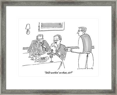 A Man Licks His Plate Clean At A Restaurant Framed Print