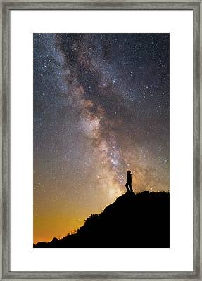 A Man On A Mountain Under The Milky Way Framed Print by Yuri Zvezdny
