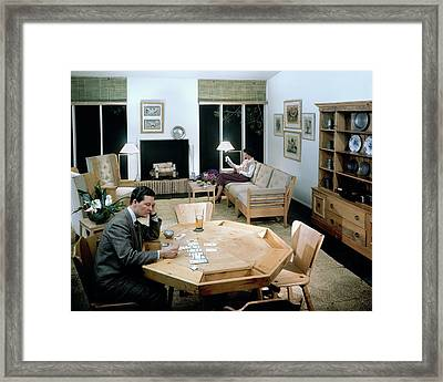 A Man Playing With Cards With A Woman Reading Framed Print by Andr? Kert?sz