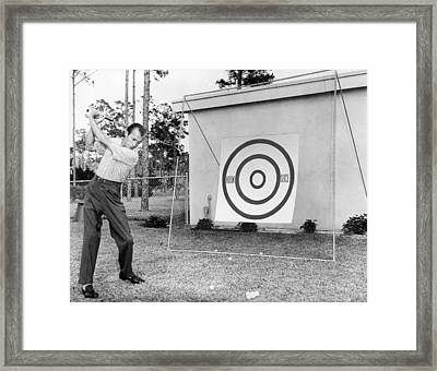 A Man Practices Golf Framed Print