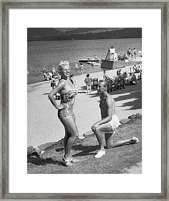 A Man Proposes On The Beach Framed Print