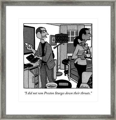 A Man Putting A Dvd In Its Cakse Speaks Framed Print