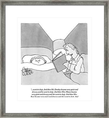 A Man Reads A Bedtime Story To His Child Framed Print