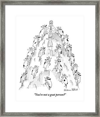 A Man Sits On Top Of A Mountain With Goats Framed Print