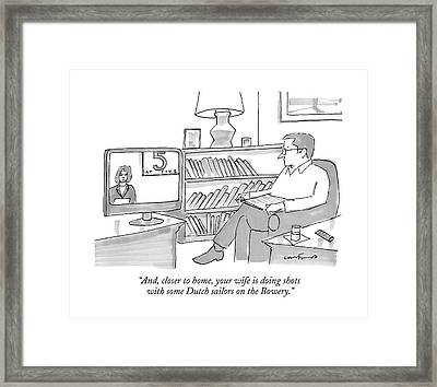 A Man Sitting At Home Watches A News Report On Tv Framed Print
