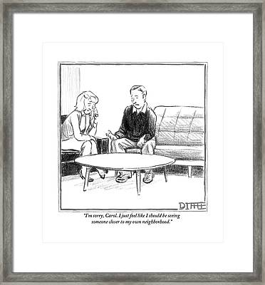 A Man Speaks To A Woman. They Are Seated Framed Print