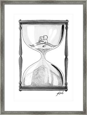 A Man Stands In The Top Half Of An Hourglass Framed Print