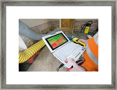 A Man Uses A Thermal Imaging Camera Framed Print by Ashley Cooper