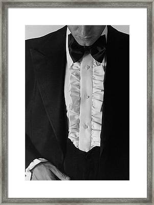 A Man Wearing A Tuxedo Framed Print by Peter Levy