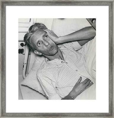 A Man Who Returned Home Swallowed A Pocket Knife Framed Print by Retro Images Archive