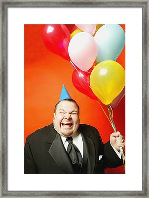 A Man With Balloons Framed Print by Darren Greenwood