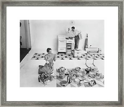 A Married Couple With Kitchen Appliances Framed Print