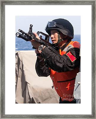 A Member Of The Chinese Peoples Framed Print by Stocktrek Images