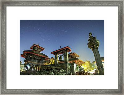 A Meteor Streaks The Sky Framed Print by Jeff Dai