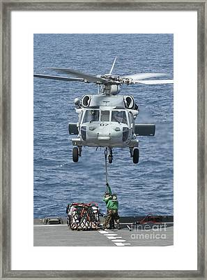 A Mh-60s Sea Hawk Helicopter Lifts Framed Print