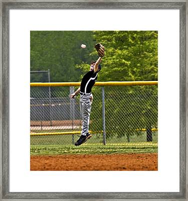 A Mighty Leap Framed Print