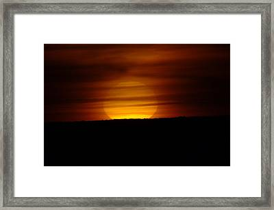 A Misted Sunset Framed Print by Jeff Swan