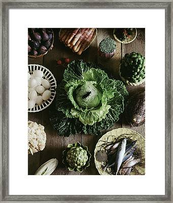 A Mixed Variety Of Food And Ceramic Imitations Framed Print by Fotiades