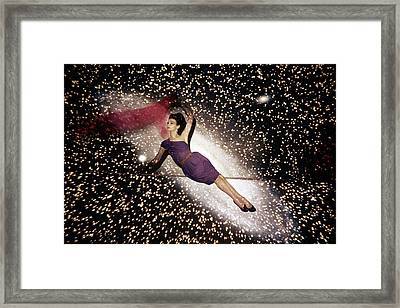 A Model Against A Galaxy Backdrop Framed Print