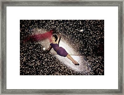 A Model Against A Galaxy Backdrop Framed Print by John Rawlings