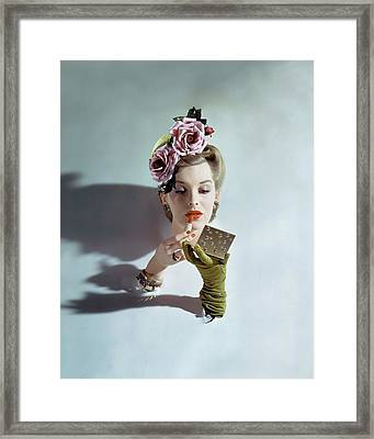 A Model Applying Lipstick Framed Print