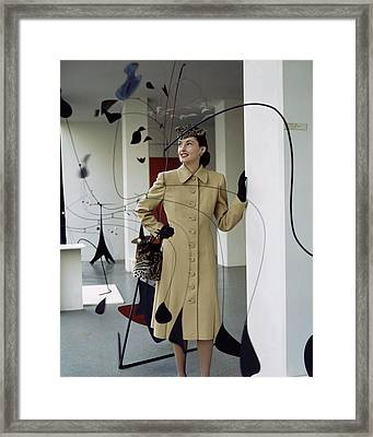 A Model Behind Calder Mobiles At The Museum Framed Print by John Rawlings