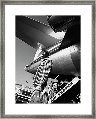 A Model By An Air France Airplane Framed Print by Richard Steedman