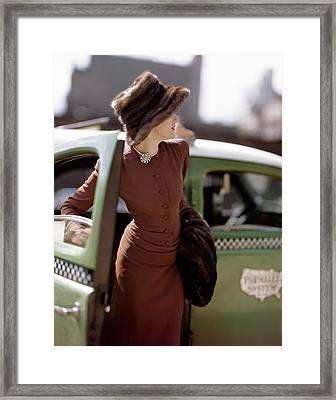 A Model Getting Out Of A Cab Framed Print by Constantin Joffe