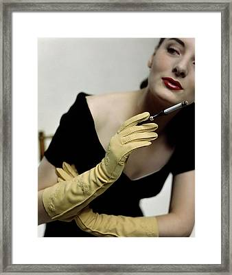A Model Holding A Alfred Orlik Cigarette Holder Framed Print by Serge Balkin